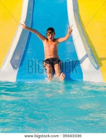 boy on a waterslide.