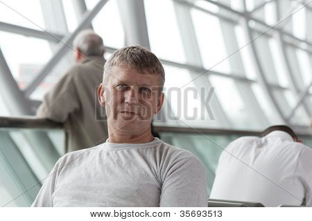 mature man in a waiting room of the international airport