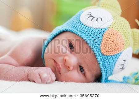 newborn baby in a bright knitted hat