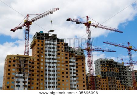 house and building cranes.