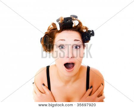 beautiful girl in hair curlers. Isolation