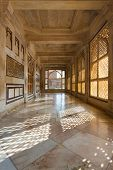 foto of empty tomb  - A hallway with beautiful intricate lattice windows in the central white marble tomb of Salim Chishti in the main courtyard at Fatehpur Sikri in Agra India - JPG