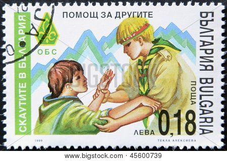 A stamp printed in Bulgaria shows a boy Scout