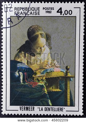 A stamp printed in France shows painting of Johan Vermeer - The Lacemaker