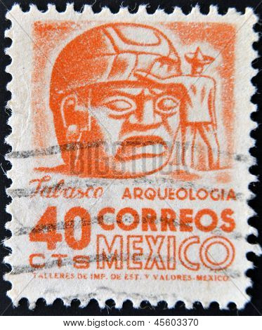 A stamp printed in the Mexico shows a giant stone head Olmec La Venta circa 1951