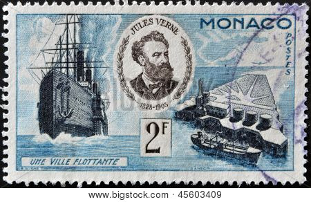 A stamp printed in Monaco shows portrait of Jules Verne series devoted to his books circa 1955