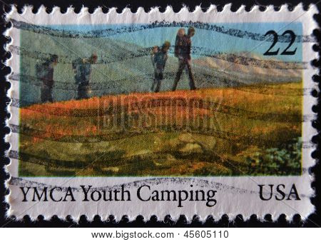 A stamp printed in USA shows YMCA youth camping