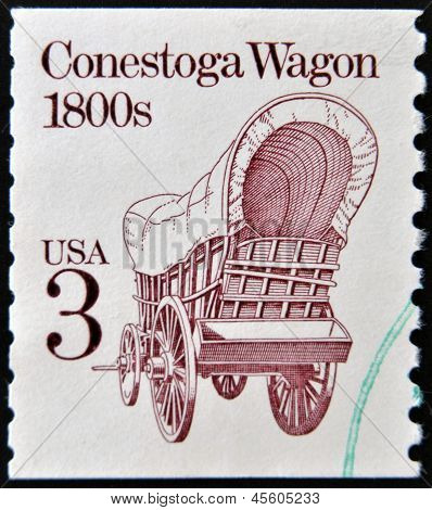 A stamp printed in USA shows Conestoga wagon 1800s