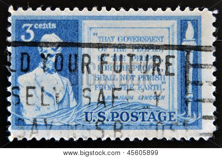 stamp printed in USA shows Lincoln and Quotation from Gettysburg Address