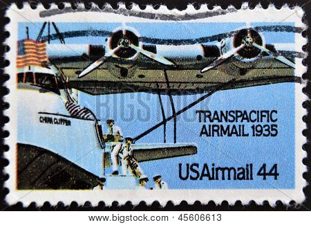 a stamp printed in USA shows plane with inscription Transpacific airmail