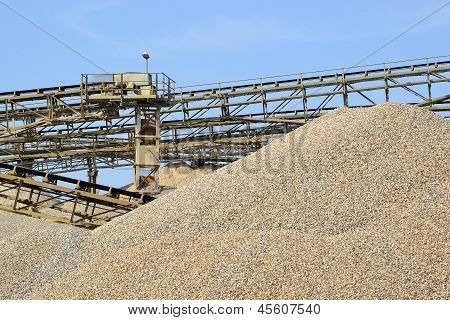 Mountains of sand and gravel in a gravel pit