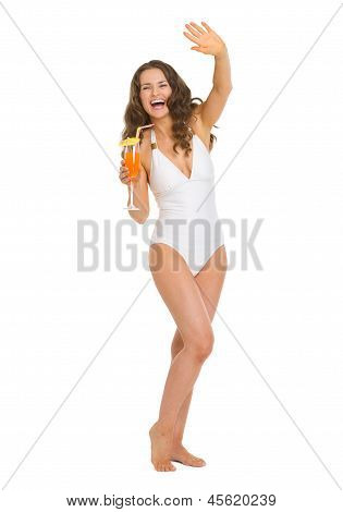 Full Length Portrait Of Smiling Young Woman In Swimsuit With Coc