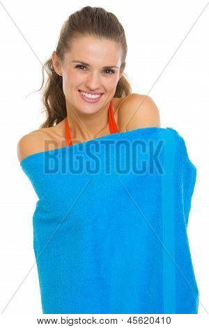Smiling Young Woman In Swimsuit Wrapped In Towel