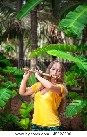 Girl Playing The Bamboo Flute
