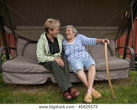 Senior Mom And Daughter Sharing A Laugh