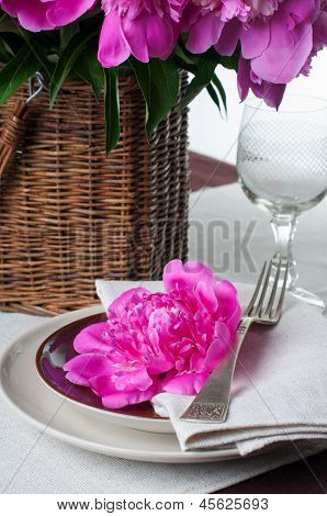 Table Setting With Pink Peonies, Vintage Cutlery And Brown Tablecloth