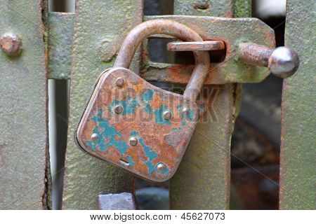 Old Rusty Padlock That Closes The Scratch Of An Ancient Prison Of Bandits