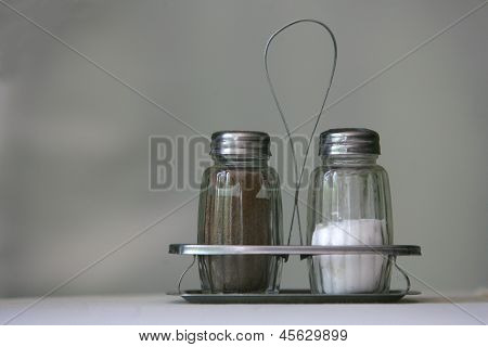 Salt And Pepper Classic Shakers On The Table