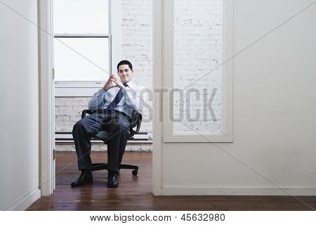 Businessman sitting in doorway