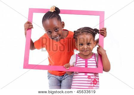 Little African American Girls Holding A Picture Frame