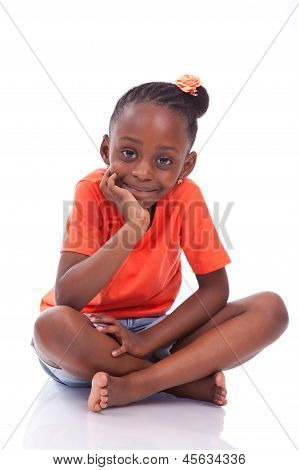 Cute Little African American Girl Sitting On The Floor - Black Children
