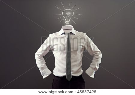 anonymous man in white shirt and black trousers having an idea over dark background
