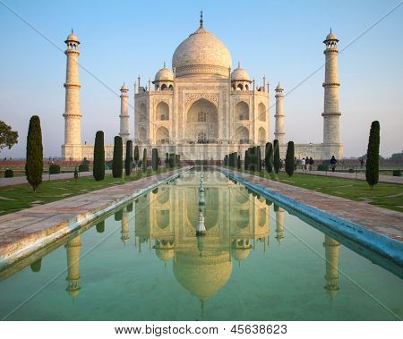 A perspective view on Taj Mahal mausoleum with reflection in water. Agra, India.