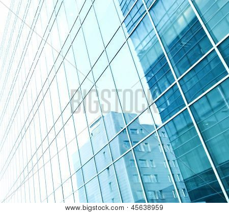 Image with reverberation of underside panoramic and perspective view to steel blue glass high rise building skyscrapers Business concept of successful industrial architecture with curve and bent lines