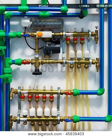 Pipes, pumps, valves and thermostats of heating system