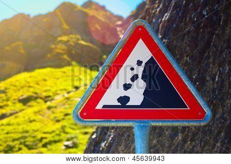 Road sign. Danger falling stones.