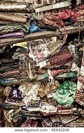 rough stacking of clothing on shelf