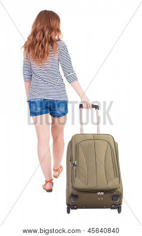 back view walking woman with suitcase. beautiful redhead girl in motion.  backside view person. Rear view people collection. Isolated over white background. Red-haired beauty rolls for a carry-on bag