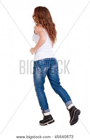 back view running woman in jeans. beautiful redhead girl in motion.Red-haired beauty in mountain boots quickly runs. backside view person.  Rear view people collection. Isolated over white background.