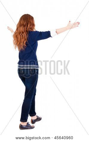 back view walking woman. beautiful redhead girl in motion.  backside view person.  Rear view people collection. Isolated over white background. happy girl goes with placed his hands open to embrace