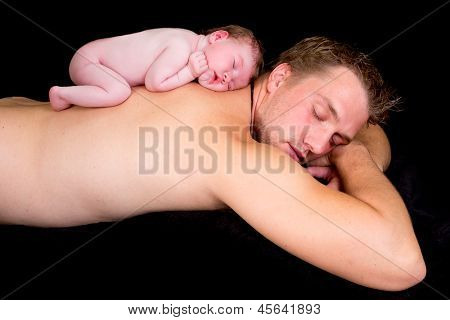 Little newborn baby of 11 days old sleeping on his father's bare back
