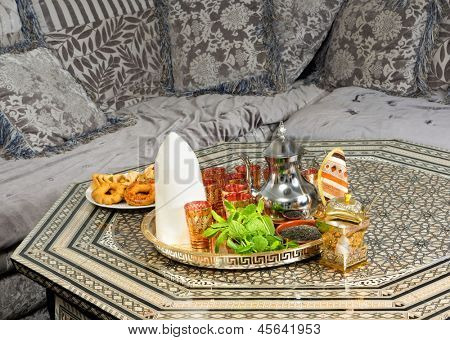 Traditional heavy Moroccan Sugar Cone or Qalib Sukar and tea tray with Ramadan cookies - sugar cones are gifts to mark the birth of babies, weddings or to pay condolences