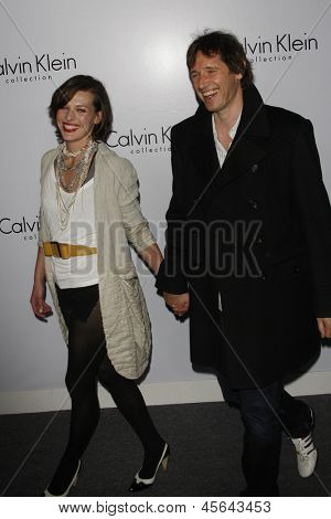 LOS ANGELES - JAN 28: Milla Jovovich, Paul W S Anderson at the Calvin Klein Collection & LA Nomadic Division 1st Annual Celebration For L.A. Arts Monthly on January 28, 2010 in Los Angeles, CA