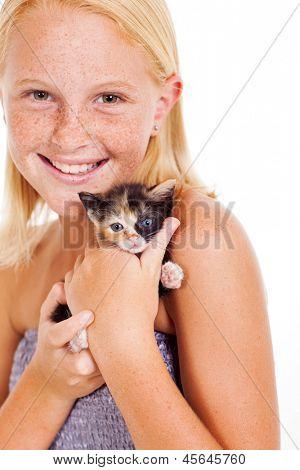 happy little girl holding kitten isolated on white