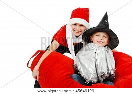 Two Happy Boys With Witch And Santa Claus Hat Having Fun In Christmas Time