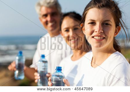fit family with water bottle after exercise in the morning