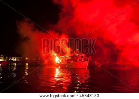 PELOPONNESE, GREECE- MAY 6: The ritual burning of Judas Iscariot at sea during the Orthodox Easter, May 6, 2013 in Peloponnese, Greece.