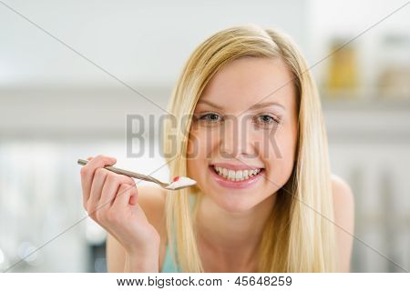 Smiling Teenager Girl With Spoon Of Yogurt