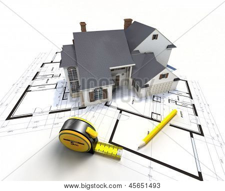 Aerial view of a house on top of blueprints and architect work tools