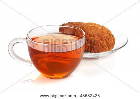 Glass cup of black tea with homemade cookies. Isolated on white background