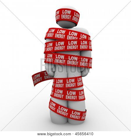 A man is wrapped in tape with the words Low Energy to illustrate being starved due to diet or having a vitamin deficiency or not eating the right food