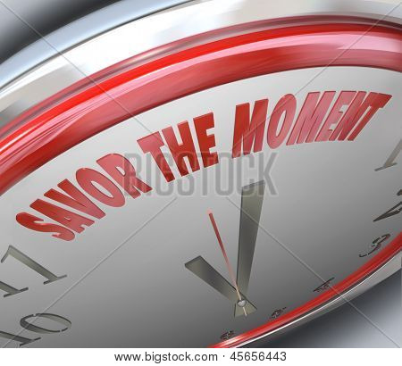 The words Savor the Moment on a clock face to illustrate the fleeting nature of time and enjoying a period of happiness and glory