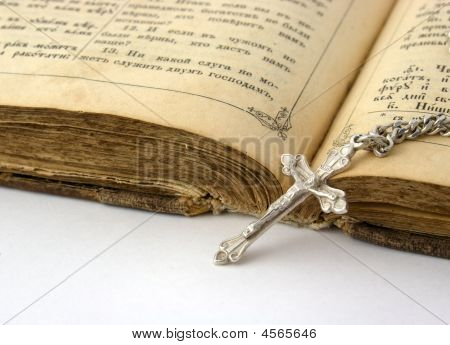 Old Bible And Silver Cross