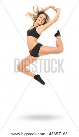 Young woman in modern dance clothes jumping