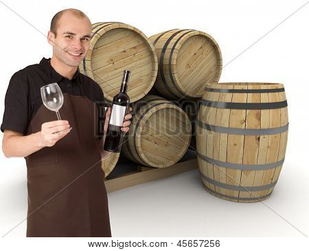Young man holding a wine bottle and a wineglass, with wine barrels at the background