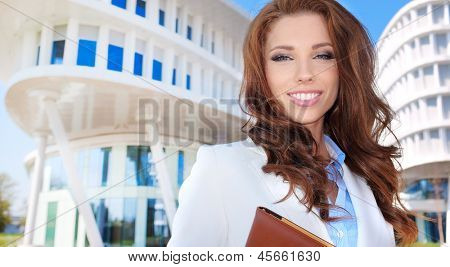 Businesswoman outside a modern office building